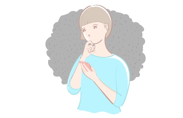スマホ片手に悩む女性